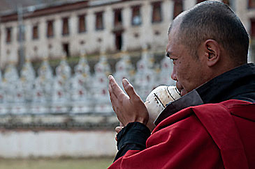 Tibetan monk blowing horn. Call to prayer