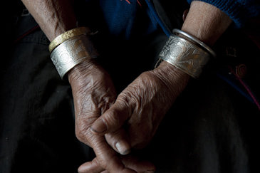 Wrinkled hands of elderly Dai ethnic minority woman